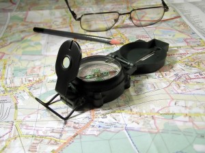 map, compass and glasses