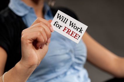 Woman holding a business card reading: Will Work For Free